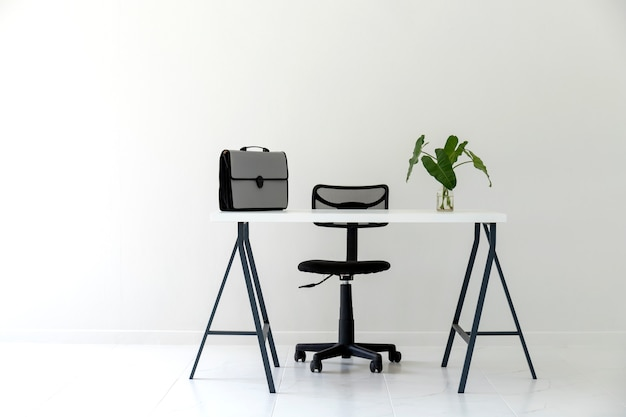 modern white office interior with white table black chair document
