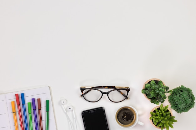 https://image.freepik.com/free-photo/modern-white-student-desk-workspace-top-view-with-text-space_2268-368.jpg