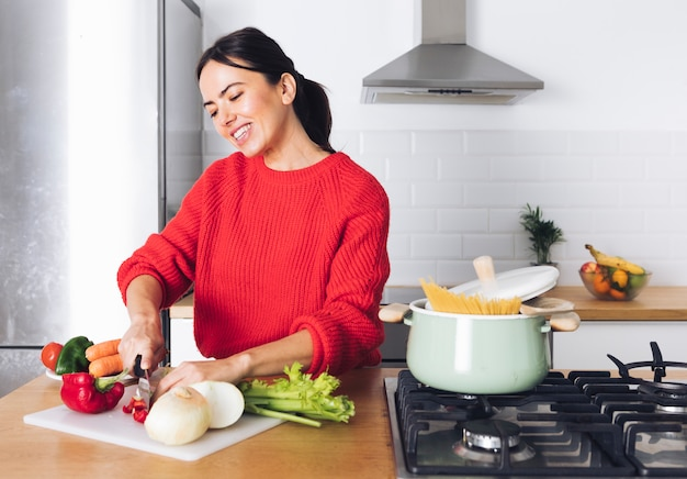 Modern woman cooking Free Photo
