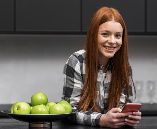 Modern woman relaxing in kitchen Free Photo