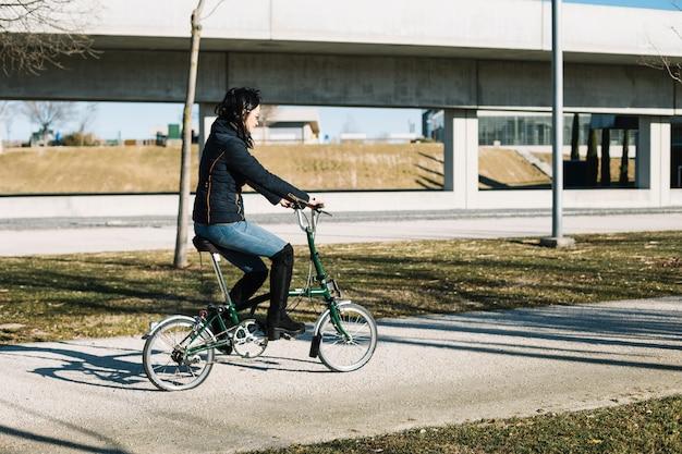 Modern woman riding bike in city Free Photo