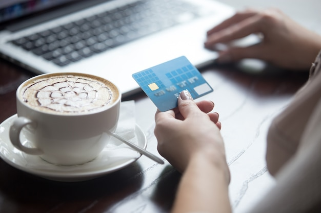 Modern woman using credit card for online payment. close-up Free Photo