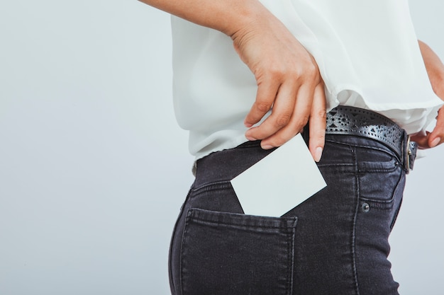 Modern woman with a business card in the pocket Free Photo