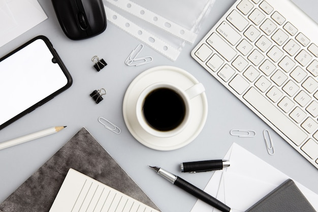 Modern workplace arrangement with cup of coffee Free Photo