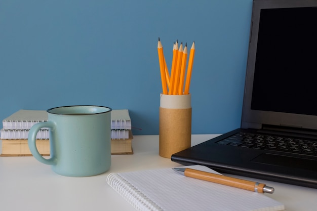 Modern workplace with laptop and office supplies Premium Photo