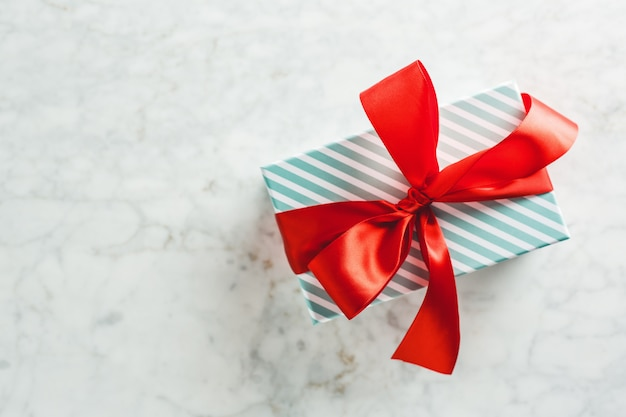 Modern wrapped gift on bright table Free Photo