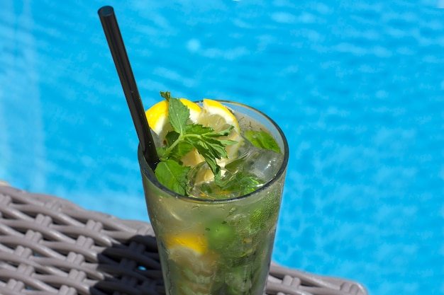 Mojito cocktail in glass on the background of the pool Premium Photo