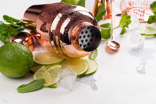 Mojito cocktail ingredients on white stone table Premium Photo