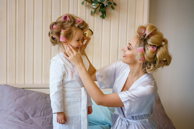 Mom and daughter make a make-up to each other, happy family relationship Premium Photo