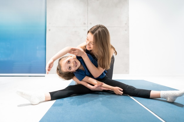 Mom and daughter do stretching before exercise Free Photo
