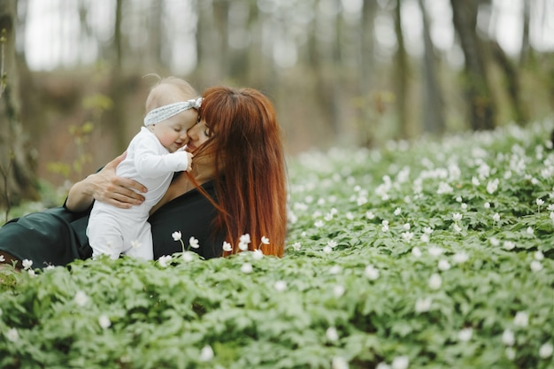 Mom hugs her little daughter with love Free Photo