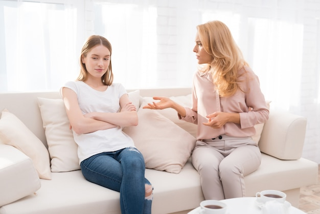Mom and a teenage daughter are arguing with each other. Premium Photo