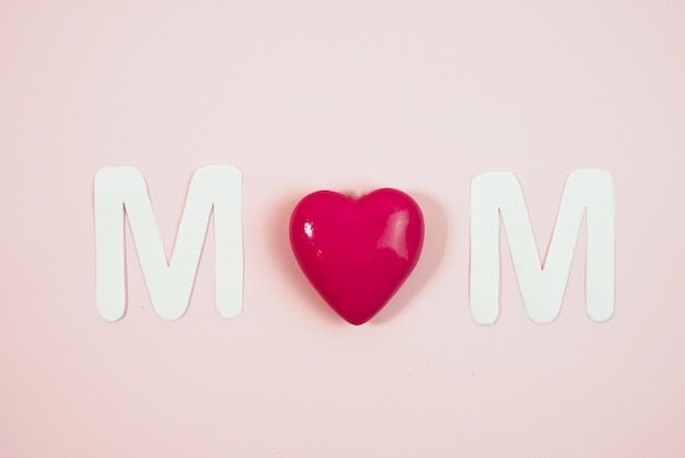 Mom text with hearts on coloful backround Premium Photo