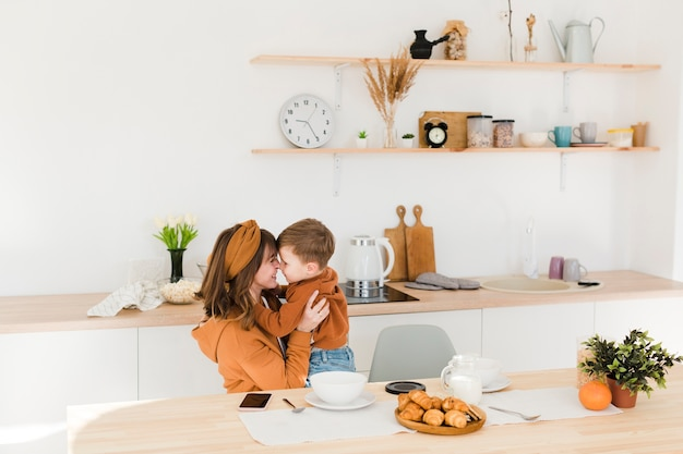 Moment of love with mother and son Free Photo