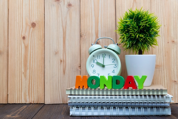 Monday letters text and notebook paper Premium Photo