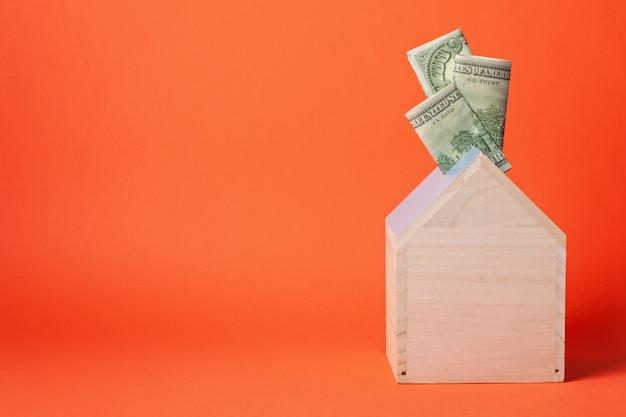 Money box full of dollars Premium Photo