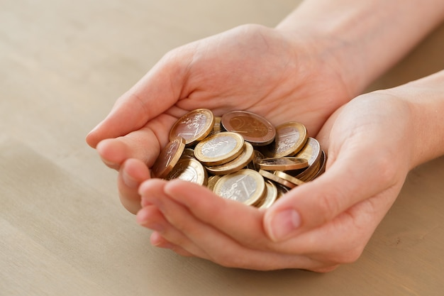 Money, finance. woman with heap of coins Free Photo