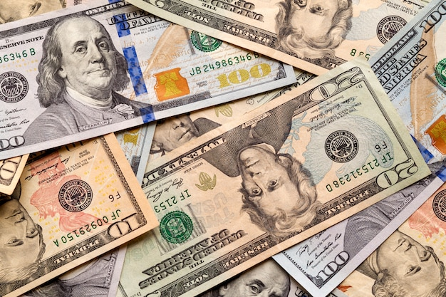 Money and finances . abstract light  of american usa national currency banknotes, details of different bills worth ten, twenty, fifty and one hundred dollars. Premium Photo