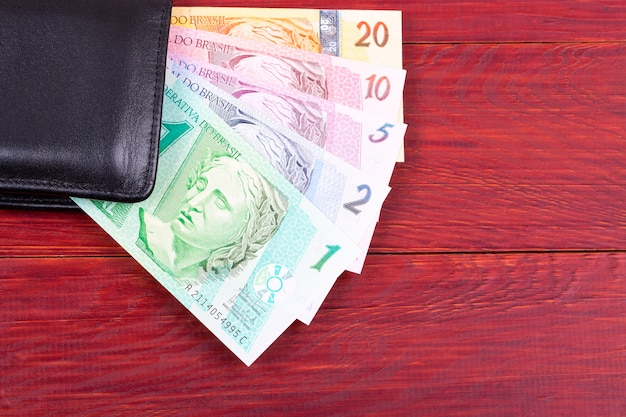 Money from brazil on a wooden background Premium Photo