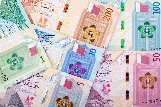 Money from qatar - riyal a background Premium Photo