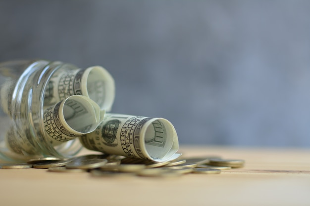 Money in the glass jar saving concept Premium Photo