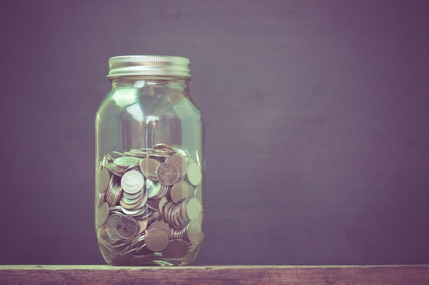 Money in the glass with filter effect retro vintage style Premium Photo
