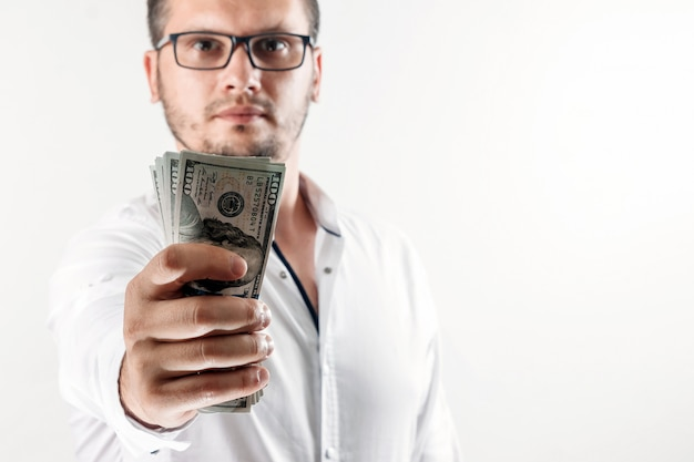 Money in the hands of a businessman Premium Photo
