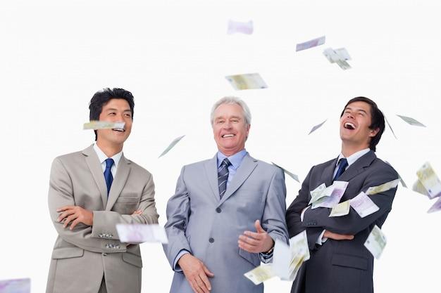 Money Raining Down On Businessteam Photo Premium Download