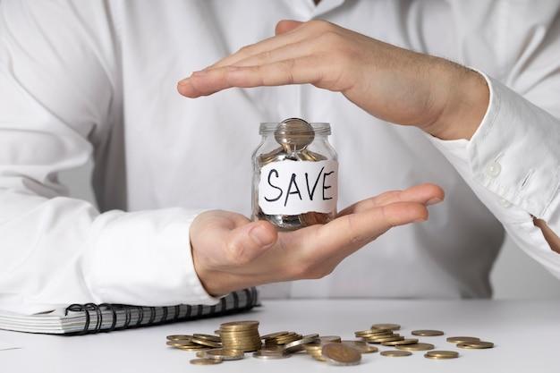 Money saving in a jar arrangement Free Photo