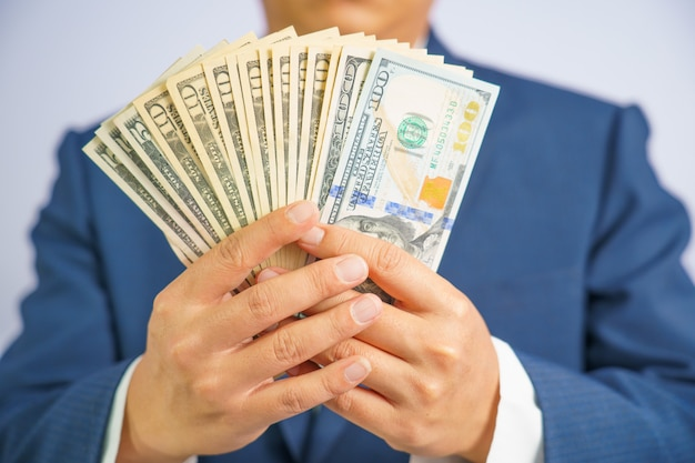Money in usa hold on hand business man wearing a blue suit Premium Photo