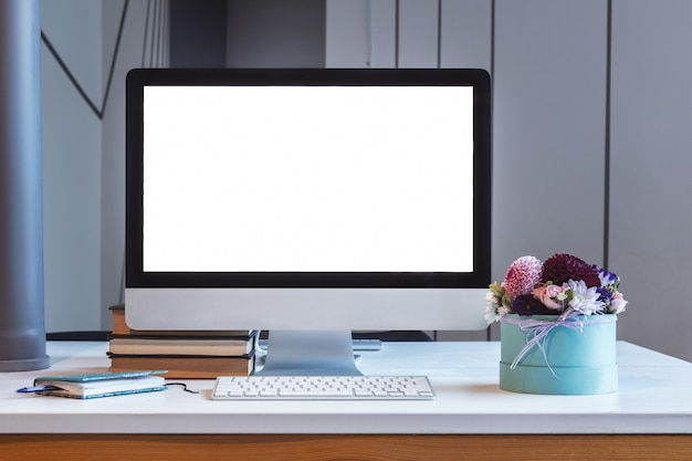 Monitor on table, blank screen, mockup Premium Photo