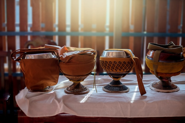 Monk's alms bowl on the table with lighting. Premium Photo