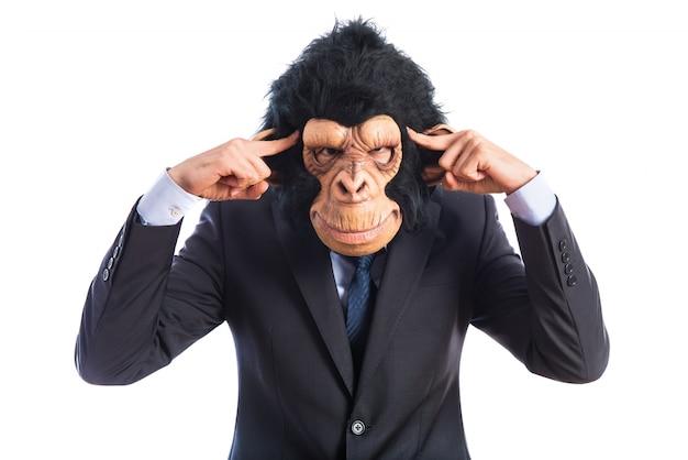 Monkey man thinking over white background Free Photo