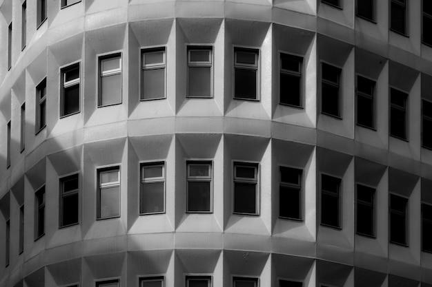 Monochromatic building with windows Free Photo