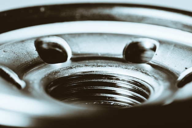 Monochrome background image of oil filter close up. Premium Photo