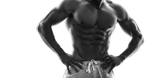Monochrome picture of muscular male torso Premium Photo