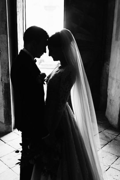 Monochrome tender photo of a wedding couple who is nearly kissing Free Photo