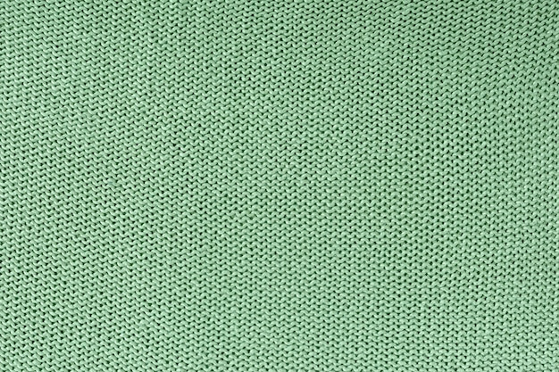 Monochrome texture of knitting. beautiful blank background with loops. Premium Photo