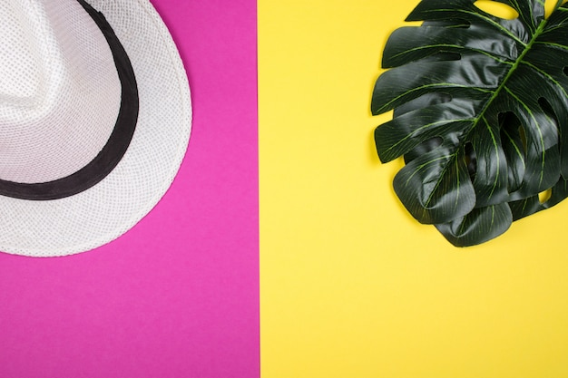 Monstera leaves and a hat Premium Photo