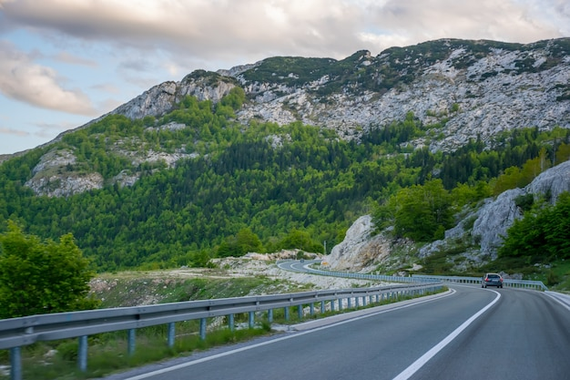 Montenegro, zabljak. tourists travel on the mountain roads of montenegro by car. durmitor. Premium Photo