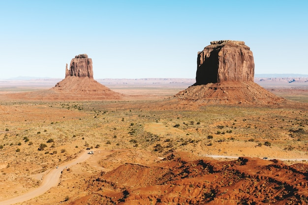 Monument valley with a clear sky  in utah Free Photo