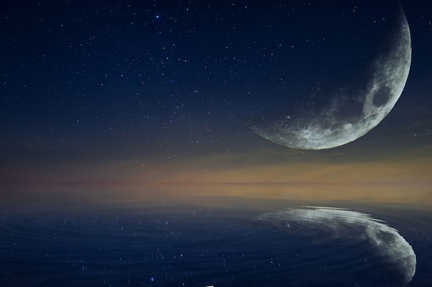 The moon and the moon reflect the water. Premium Photo