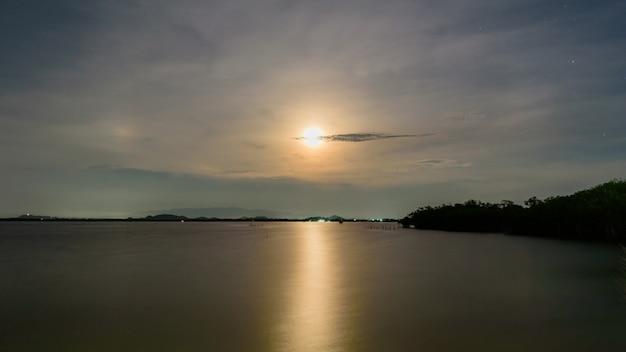 Moon sky and light moon on water Premium Photo