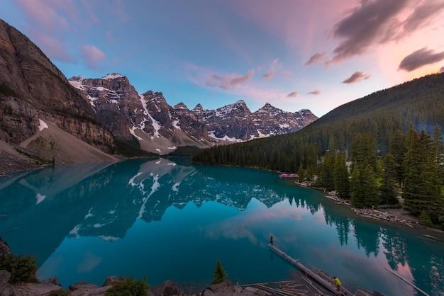 The moraine lake with turquoise lake and mountain reflection in sunset beautiful sky Premium Photo