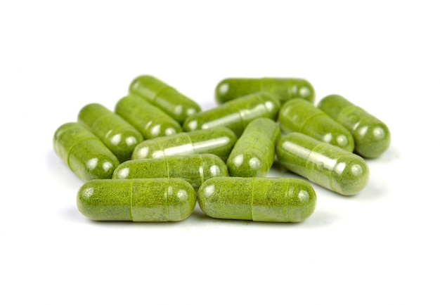 Moringa capsule pills on white background Premium Photo