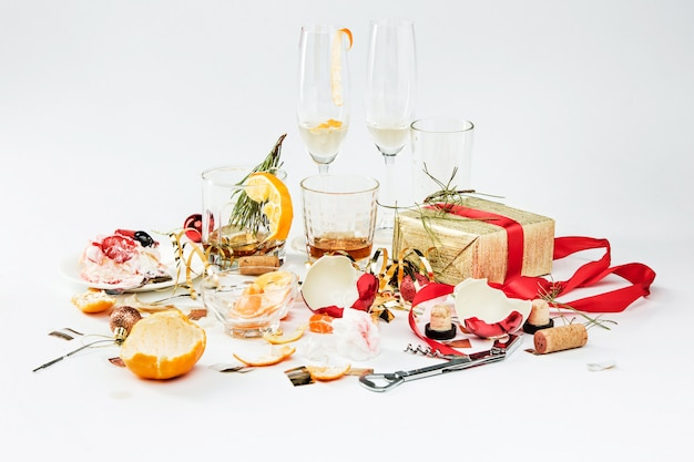 The morning after christmas day, table with alcohol and leftovers Free Photo