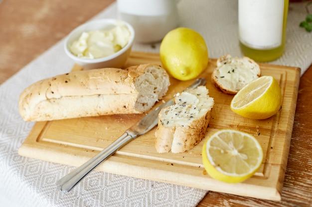 Morning breakfast bread and butter lemons Premium Photo