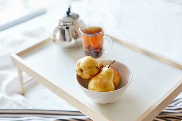 Morning breakfast bread and butter, tea and pear Premium Photo