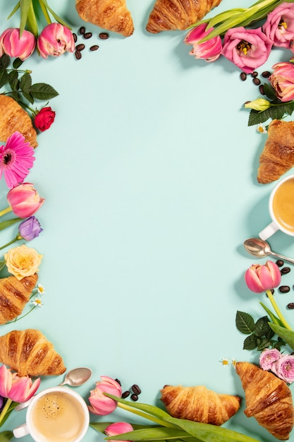 Morning coffee, croissants and a beautiful flowers. flat lay Premium Photo