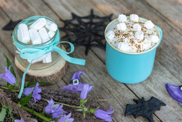 Morning coffee with marshmallow slices. the day of halloween. Premium Photo